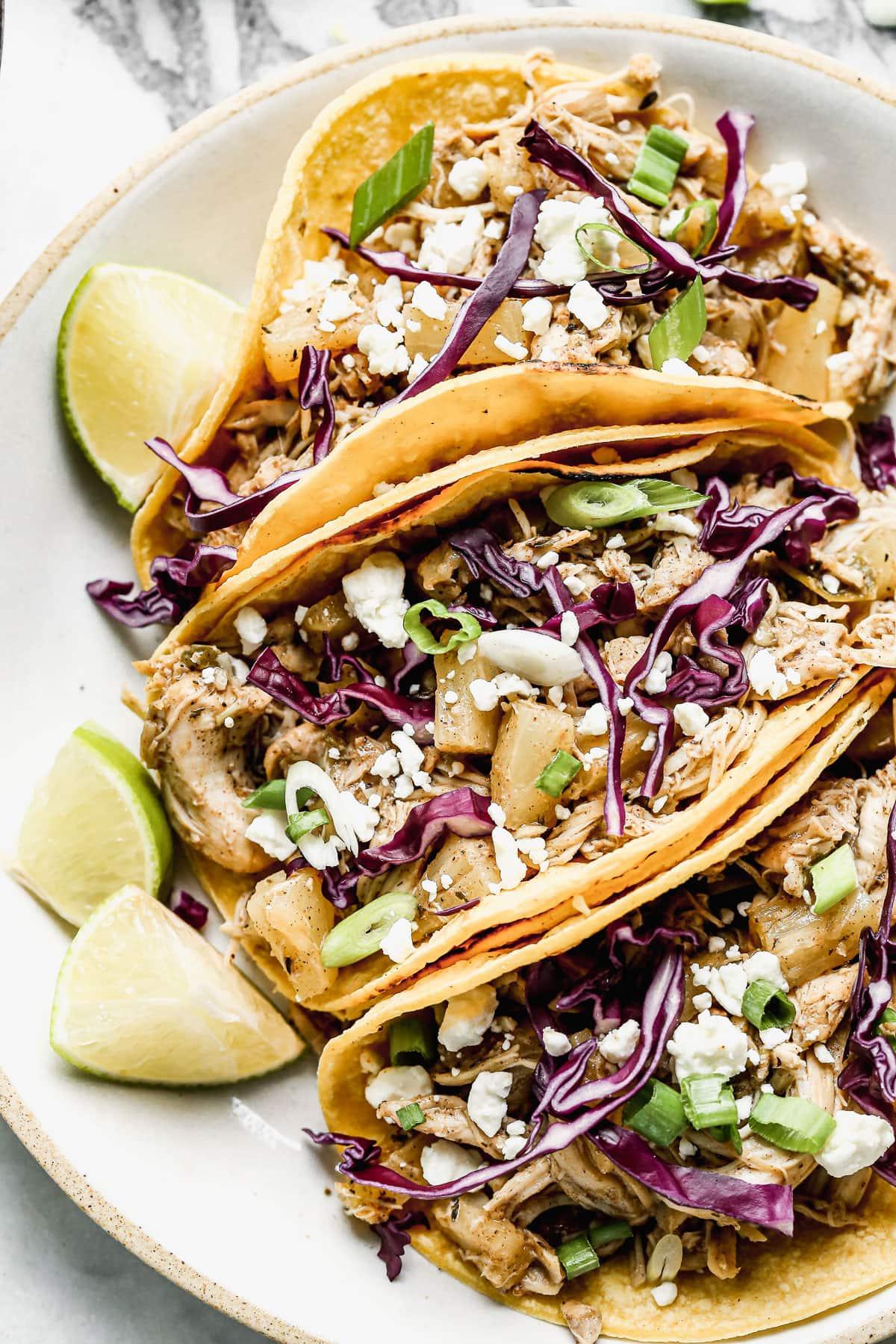 Three jerk chicken tacos on a plate