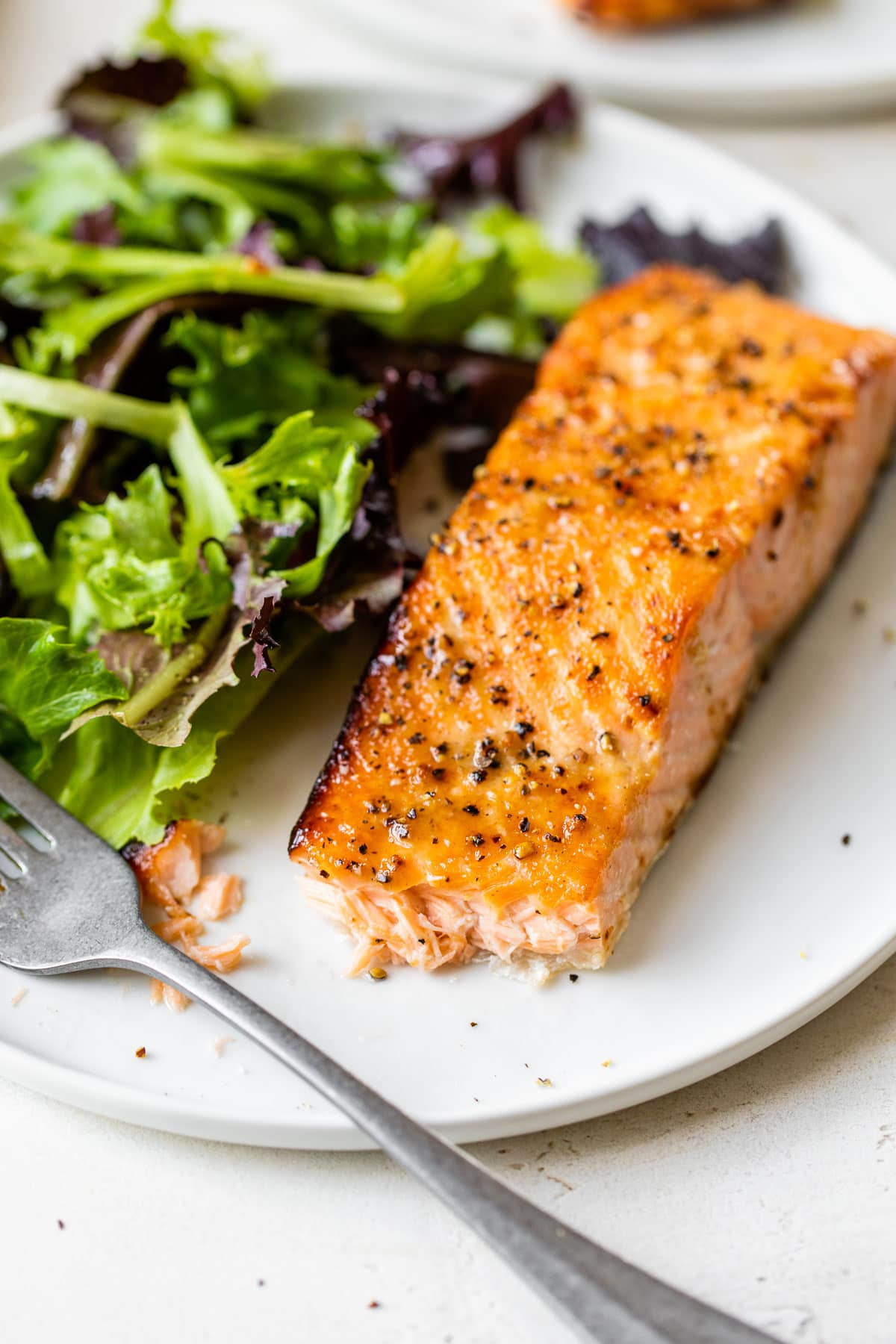 Air fryer salmon on a plate with salad