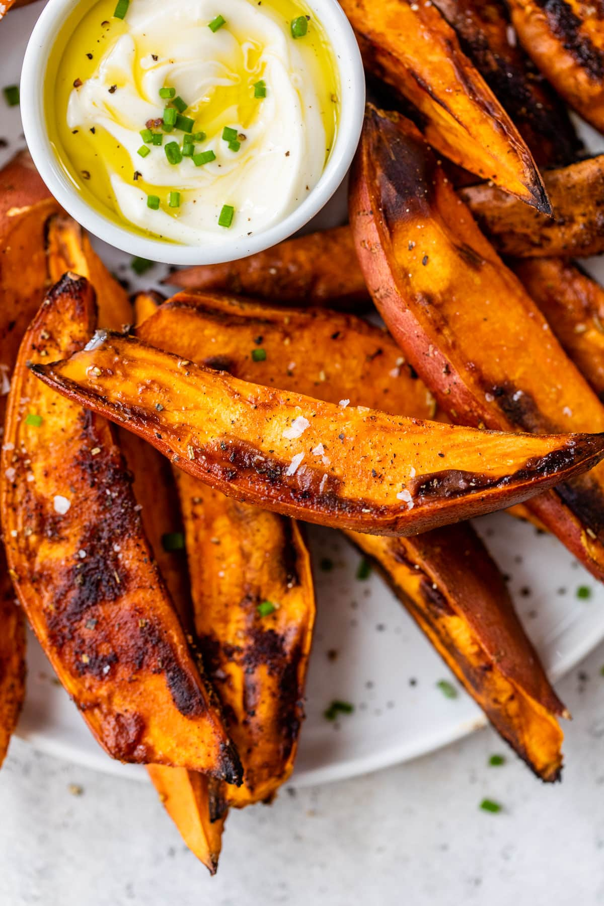 Sweet potato wedges on a plate with dip