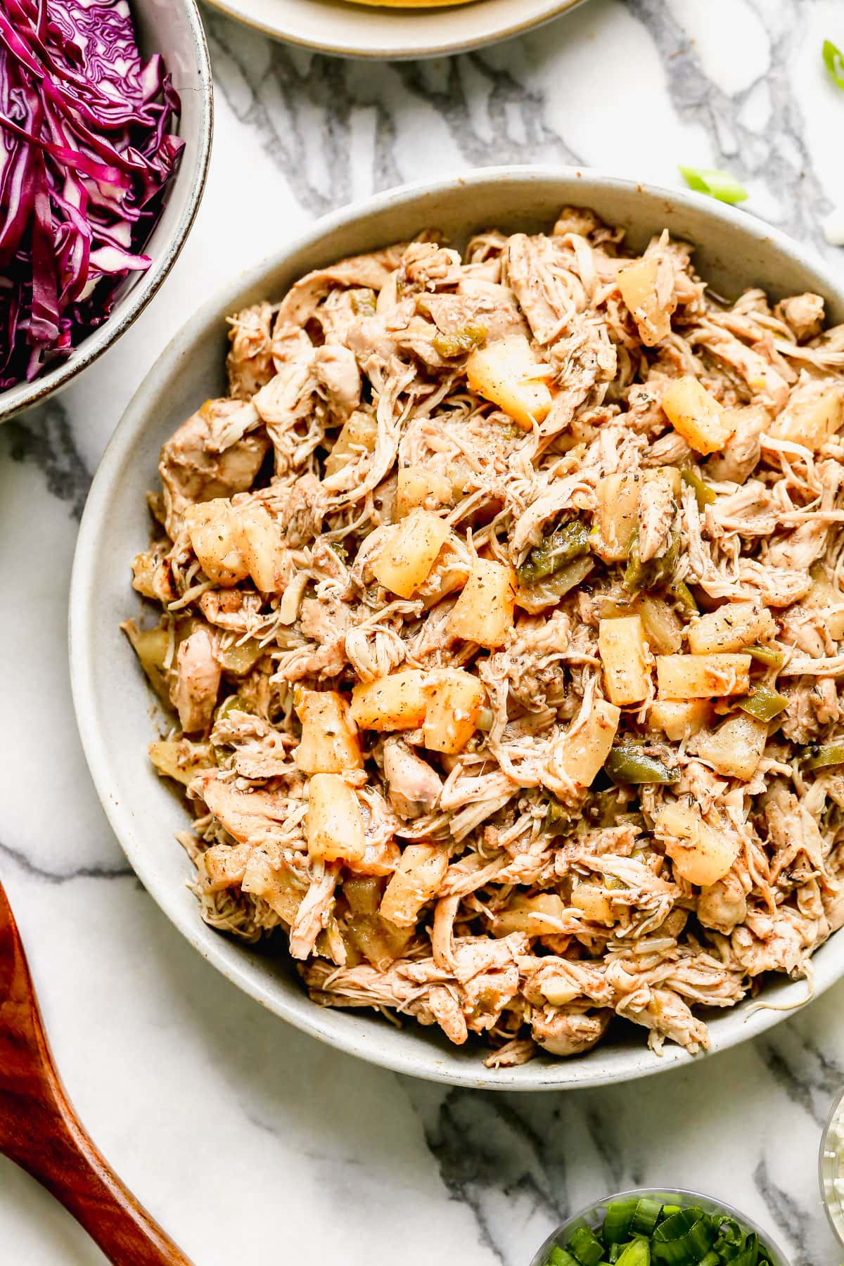 Shredded chicken and pineapple in a bowl