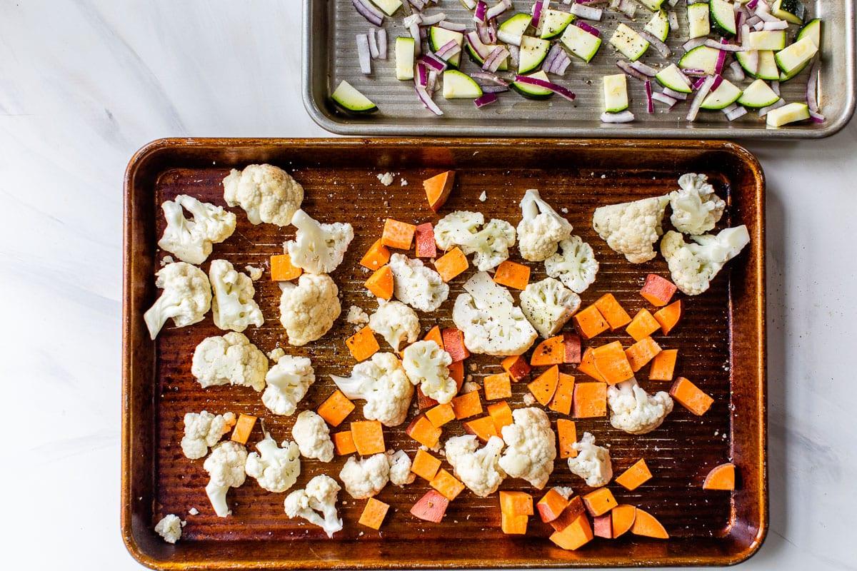 Cauliflower and sweet potato on a baking sheet