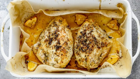 Two baked bone in chicken breasts with lemon