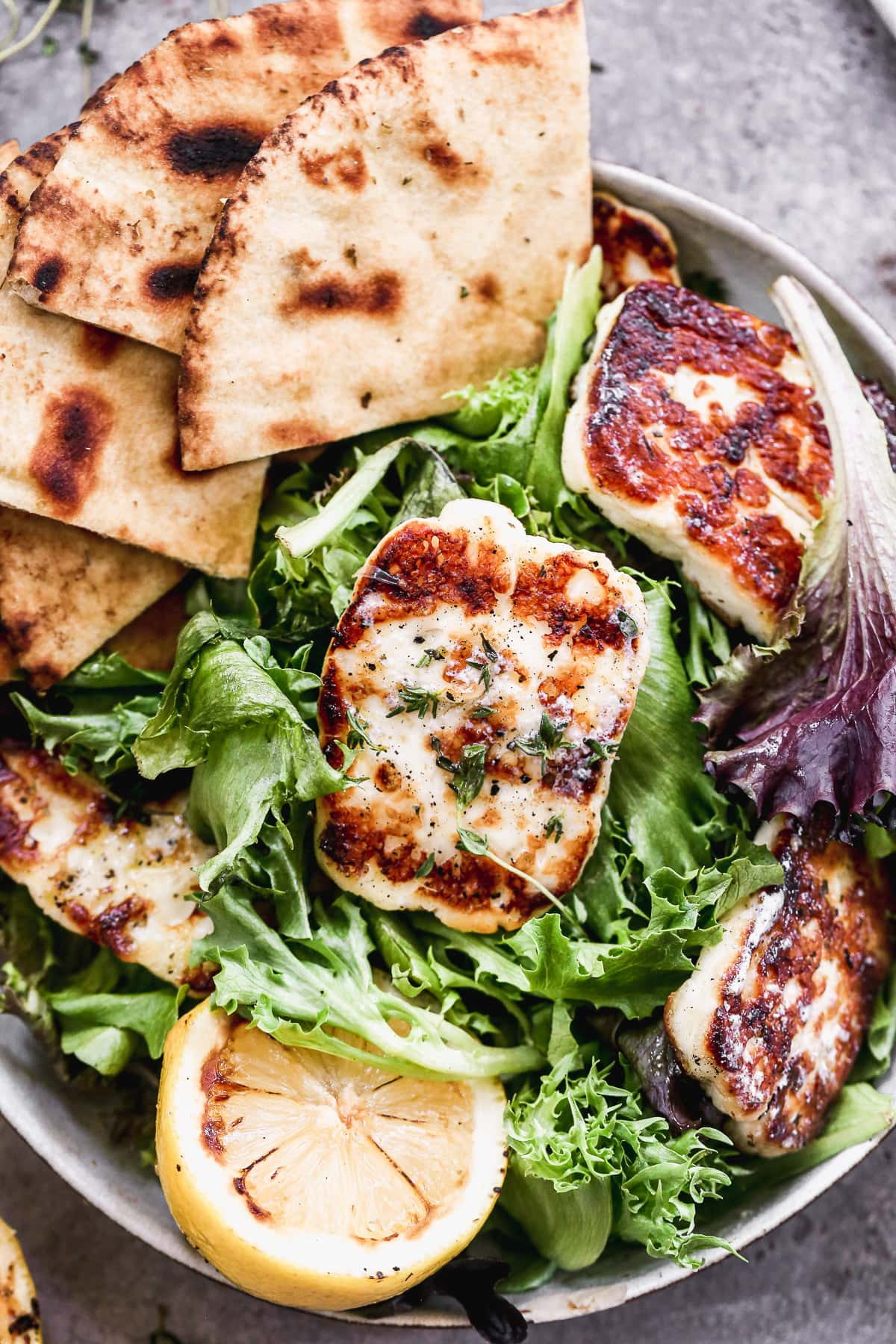 grilled halloumi cheese salad on on a plate