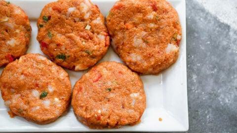 shrimp burger patties on a plate