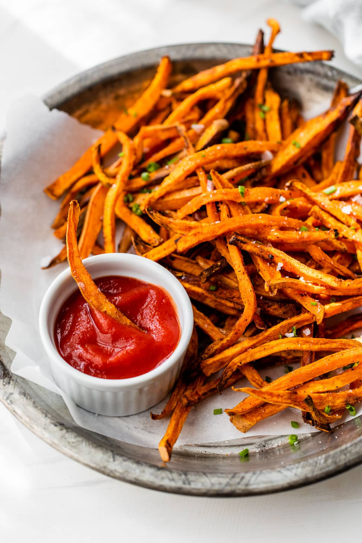 air fryer sweet potato fries on a plate