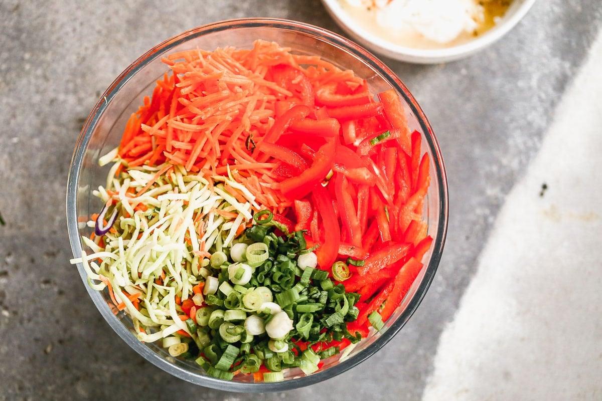 healthy coleslaw recipe ingredients in a bowl