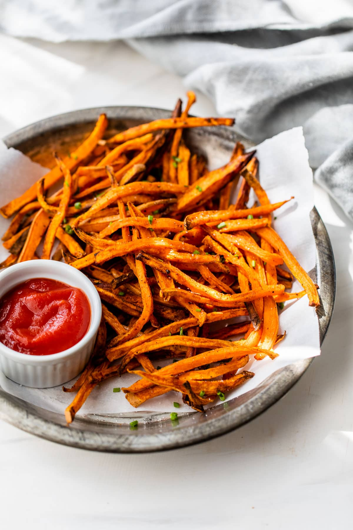 crispy air fryer sweet potato fries on a plate