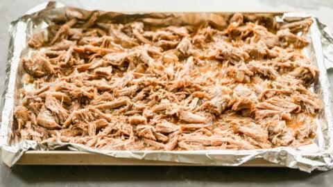 shredded instant pot pork carnitas on a baking sheet