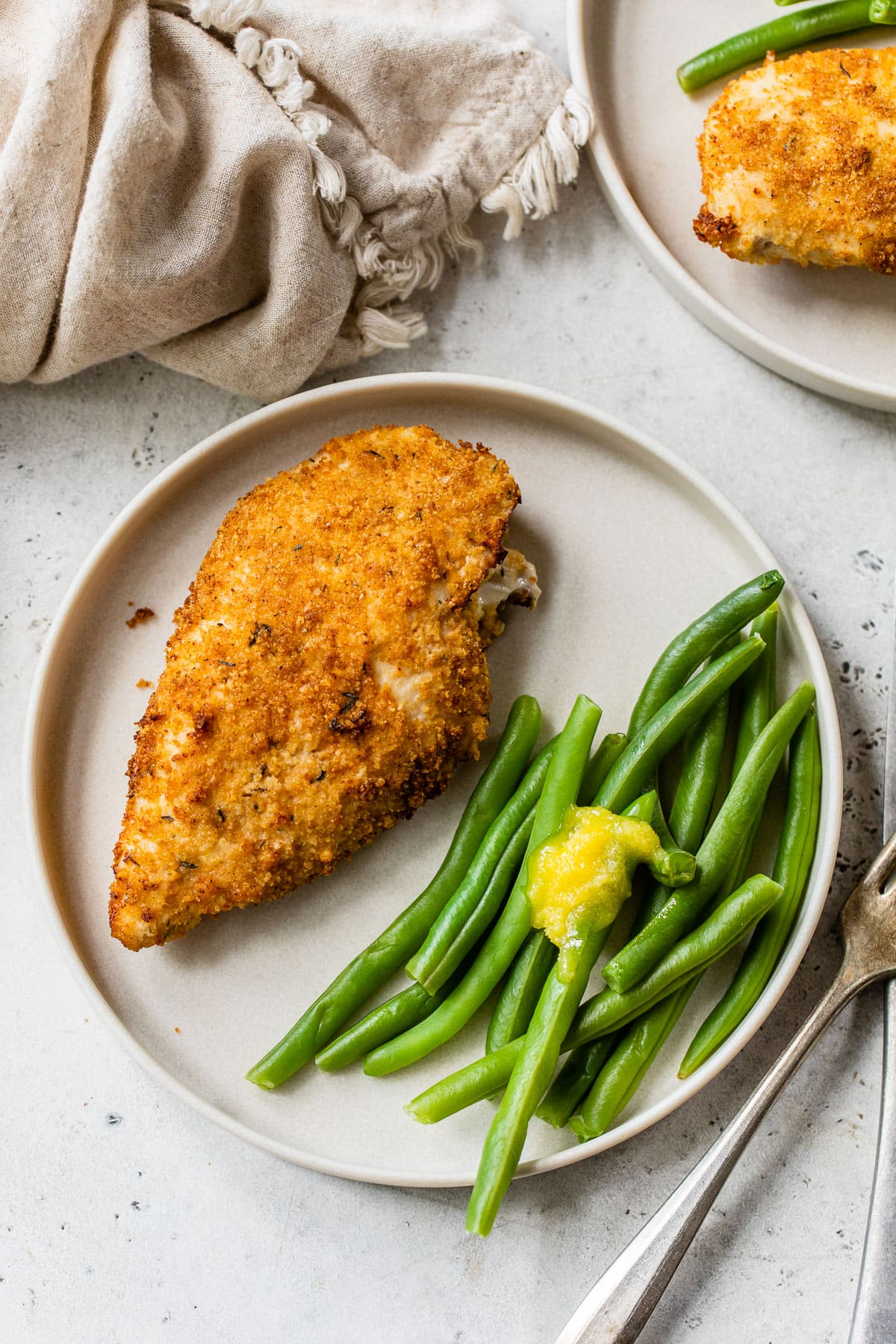 crispy air fryer fried chicken breast and green beans on a plate