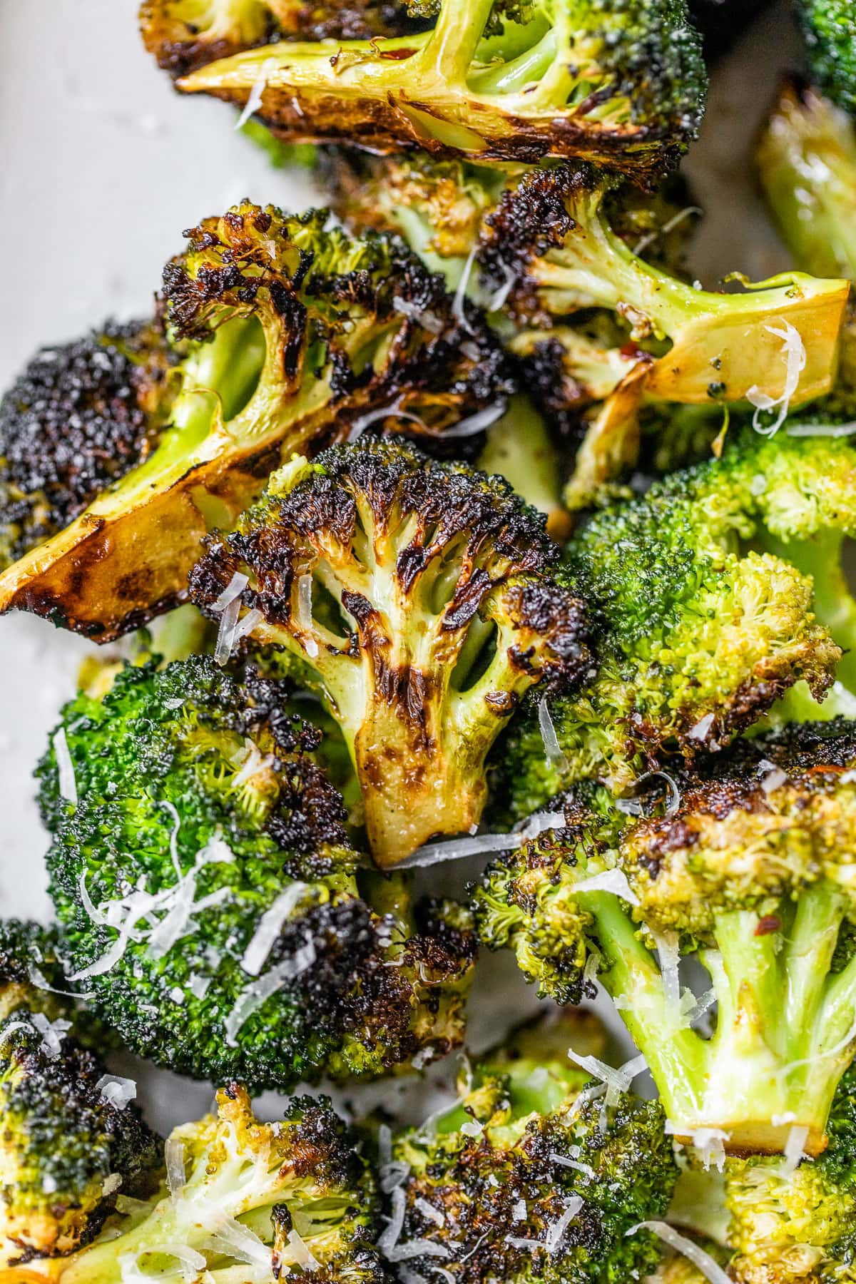 crispy grilled broccoli with Parmesan on a plate
