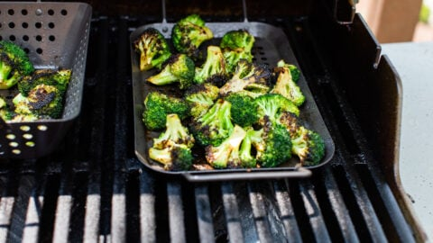 grilling broccoli in a grill basket