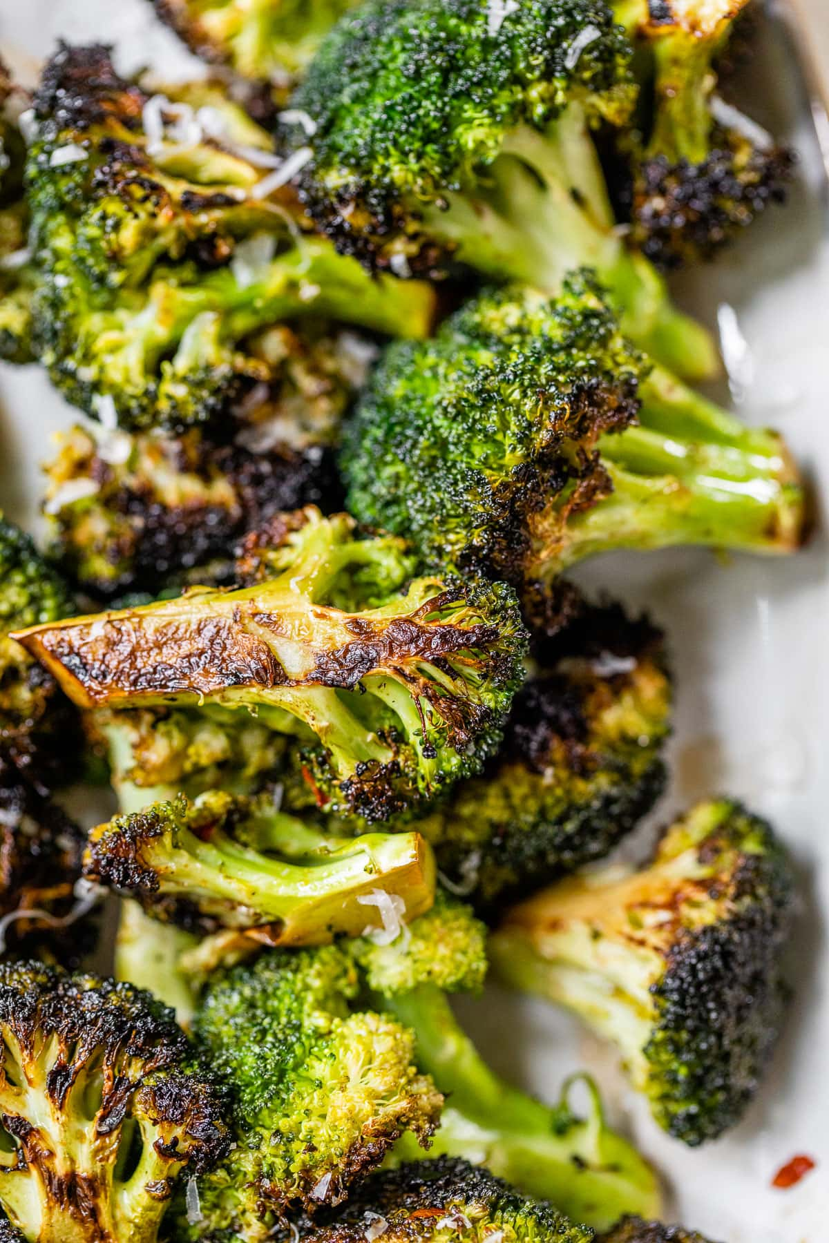 grilled chopped broccoli on a plate