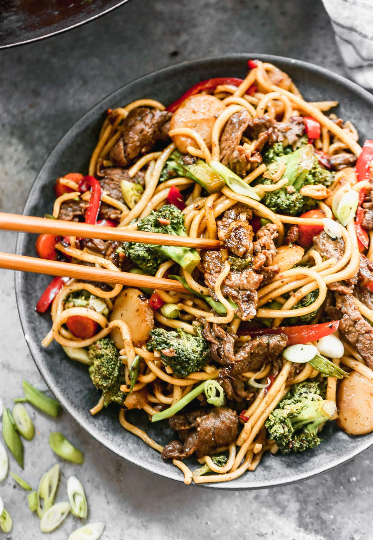 beef lo mein recipe with broccoli on a plate