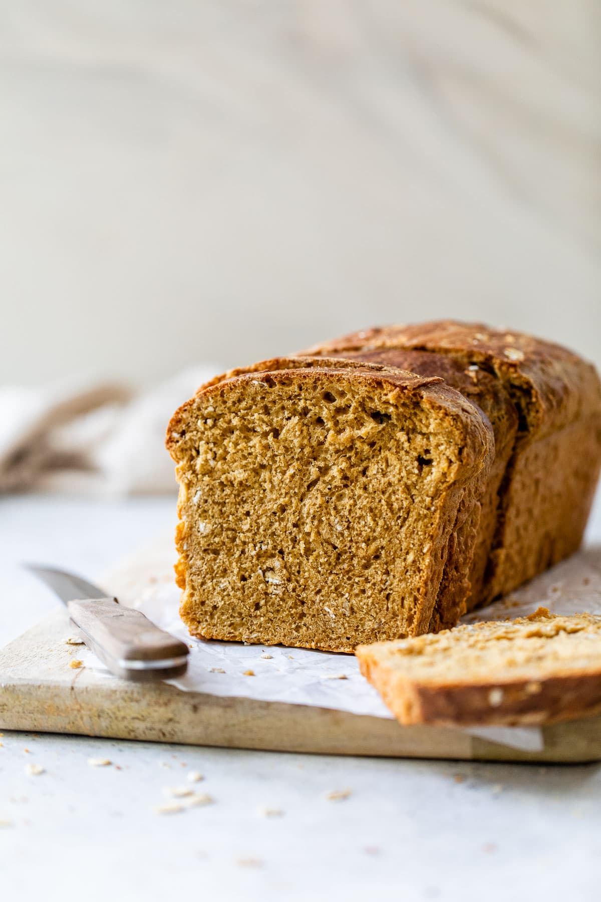 a loaf of fluffy homemade oatmeal bread cut into slices