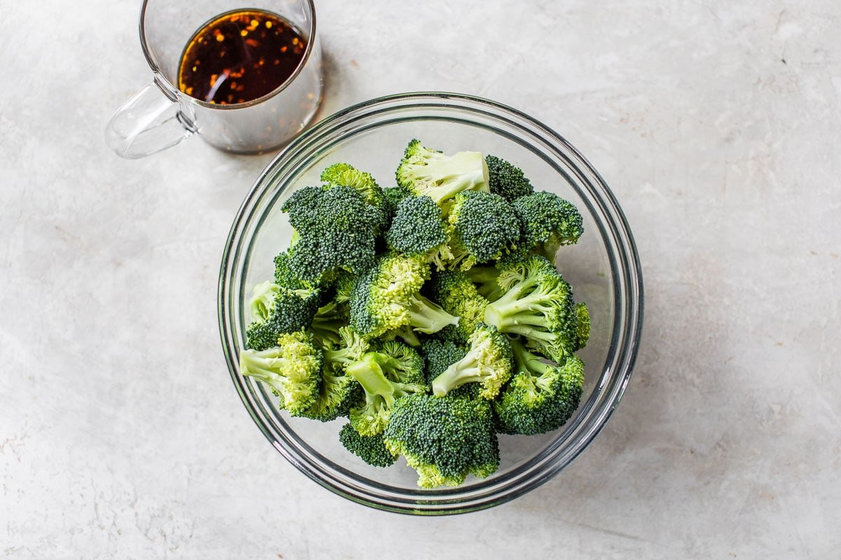chopped broccoli in a bowl with seasoning