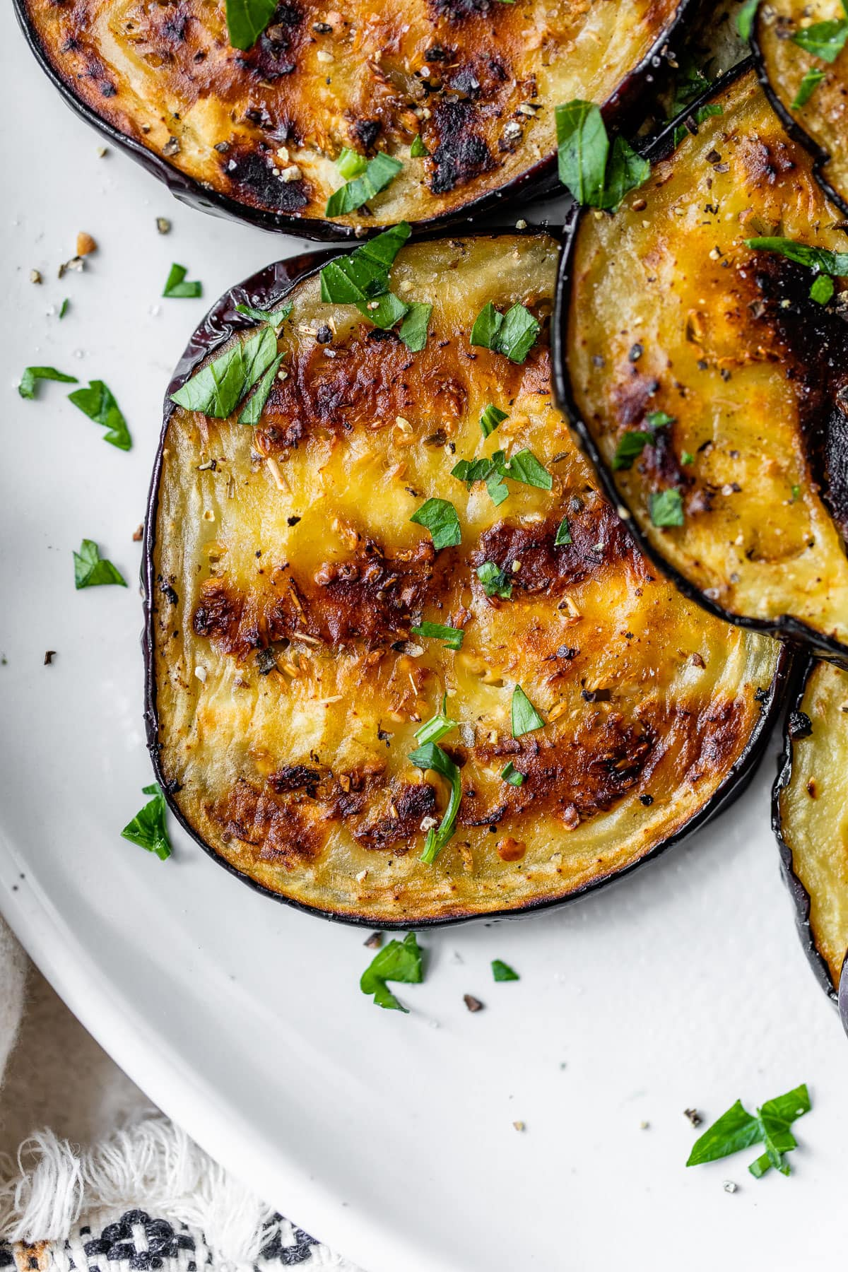 slices of eggplant grilled for dinner on a plate