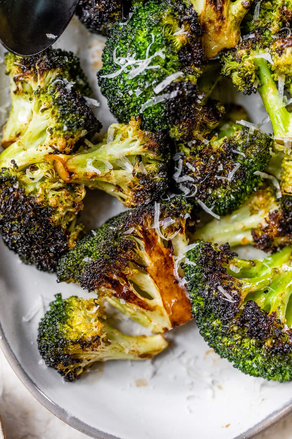 grilled broccoli with Parmesan on a plate