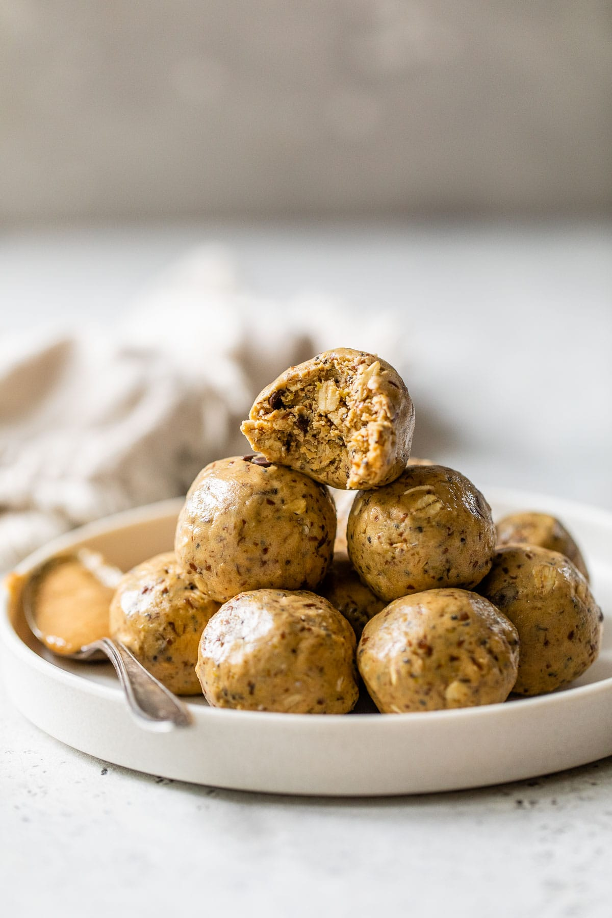 low calories peanut butter protein balls stacked on a plate
