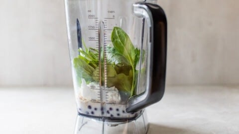 blueberries, spinach, milk, and oats in a blender