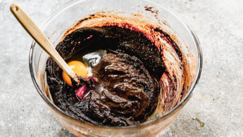 stirring eggs into brownie bite batter