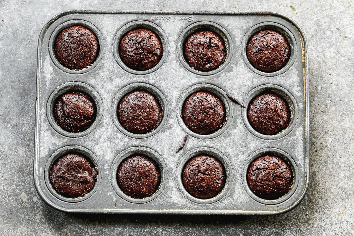 baked brownie bites cooling in a mini muffin tin