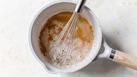 white vinegar, apple cider vinegar, and honey in a saucepan