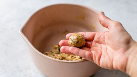 peanut butter protein balls rolled smooth by hands