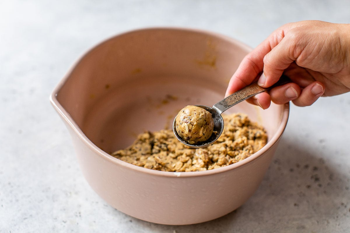 peanut butter protein ball ingredients scooped in a bowl