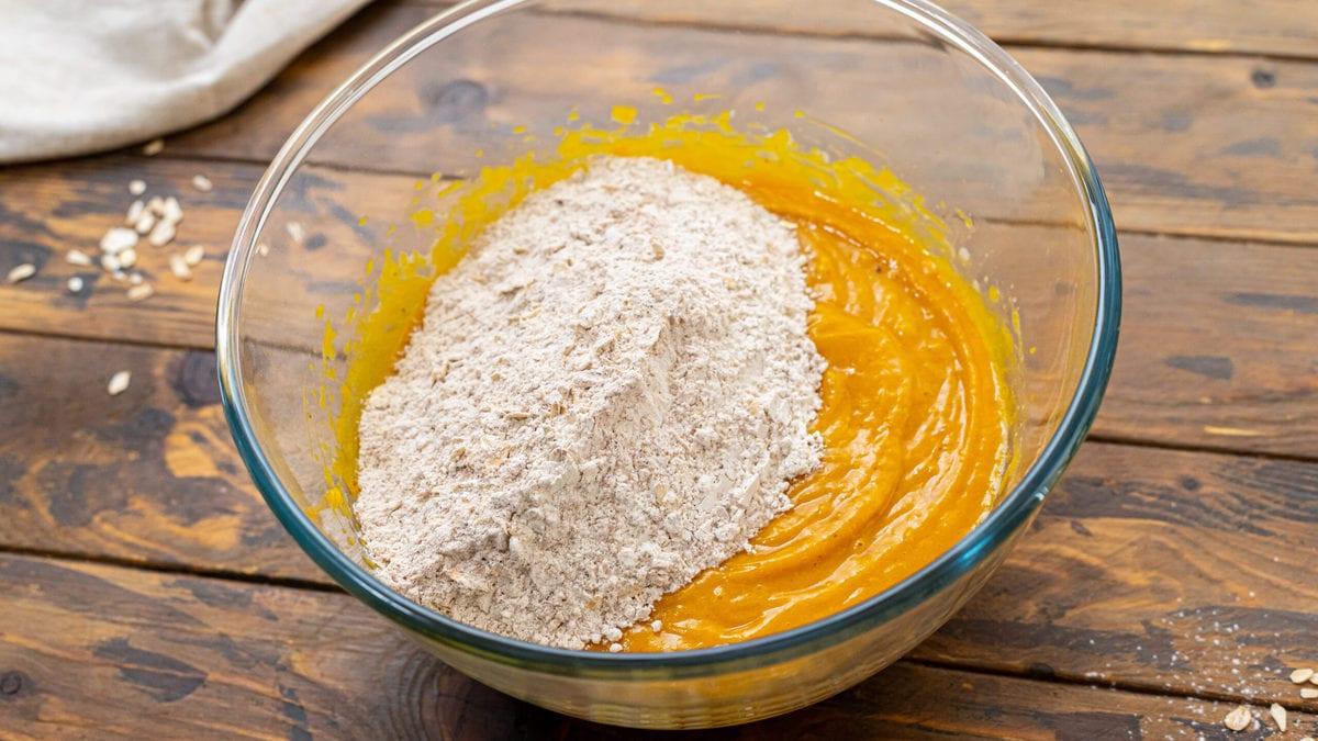 Adding dry ingredients to wet ingredients for pumpkin bread