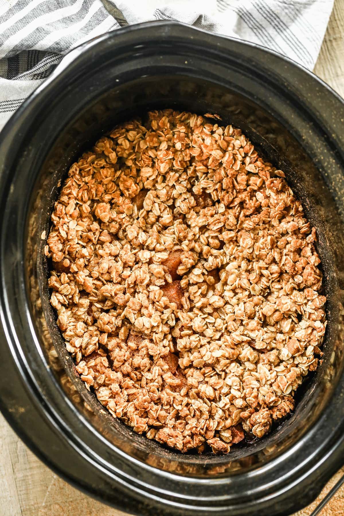 A slow cooker with apple crisp