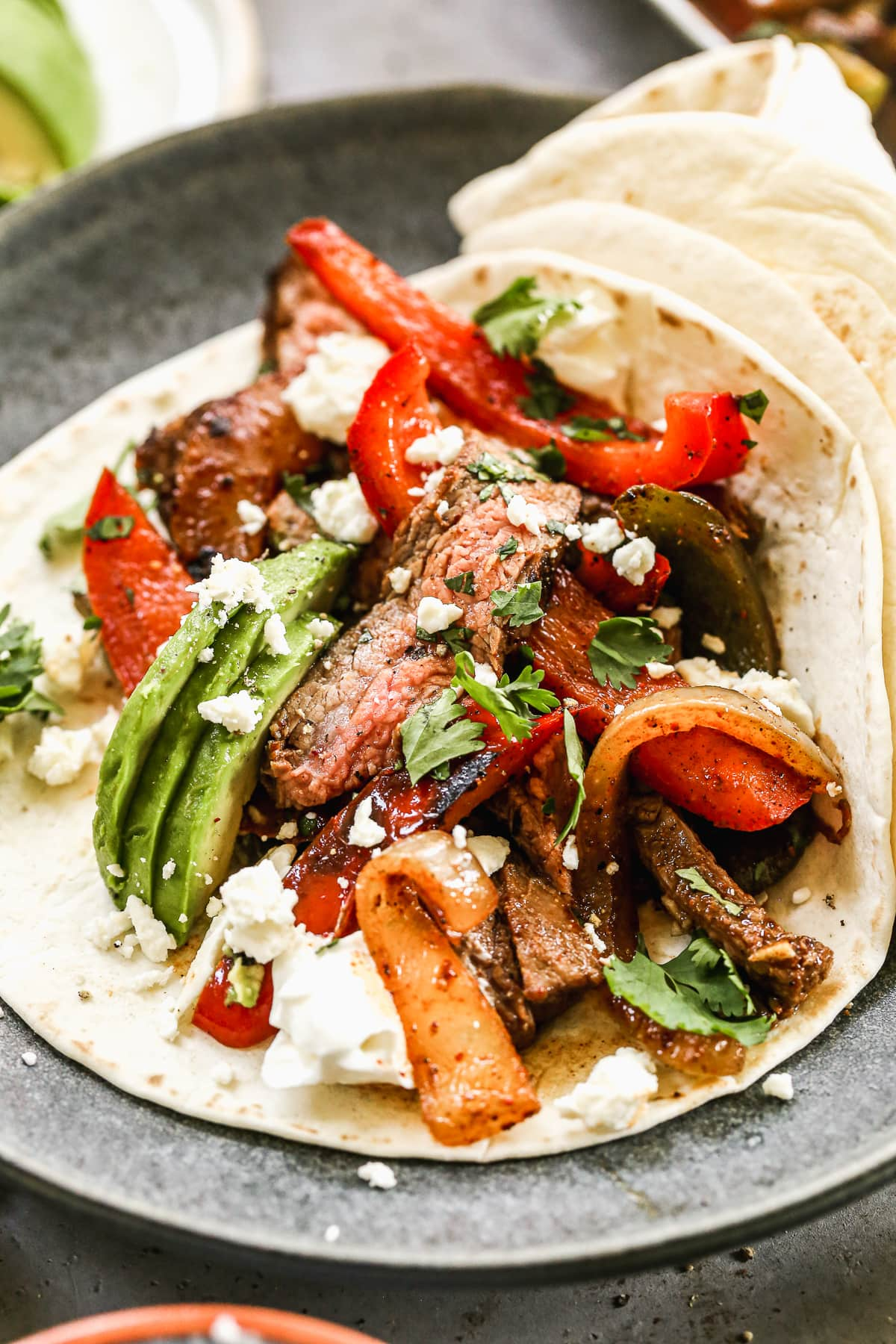 Tender beef fajitas with cheese and avocado