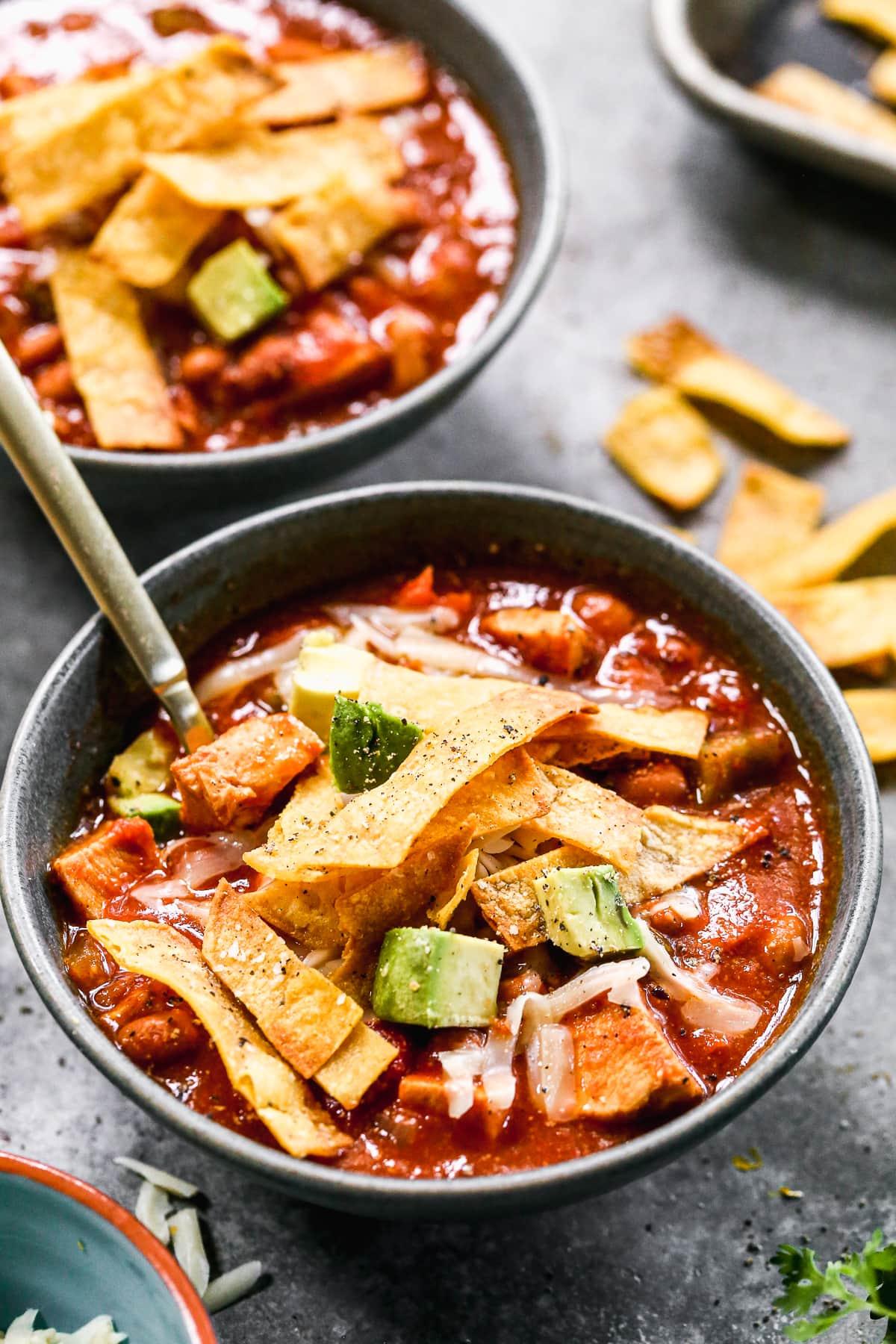 Healthy chicken tortilla soup with avocado