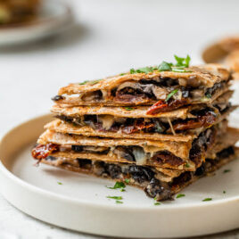 a stack of cheesy mushroom quesadillas that are healthy