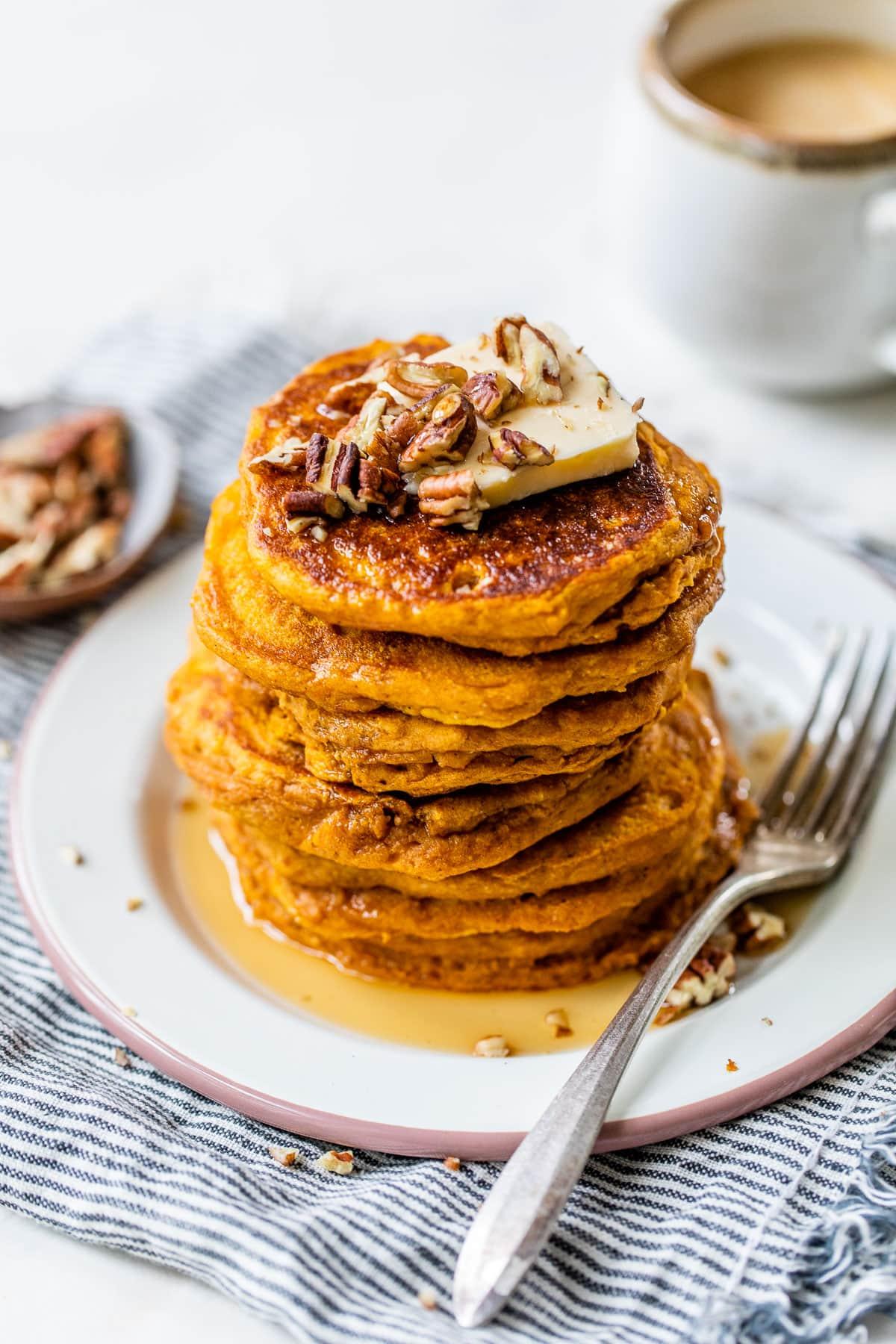 Whole wheat healthy pumpkin pancakes on a plate