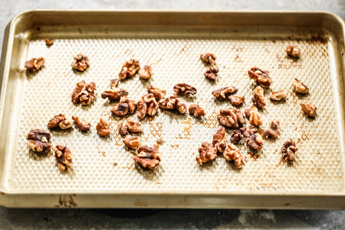 toasted walnuts on a sheet pan
