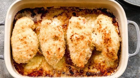 Four chicken breasts in a baking dish