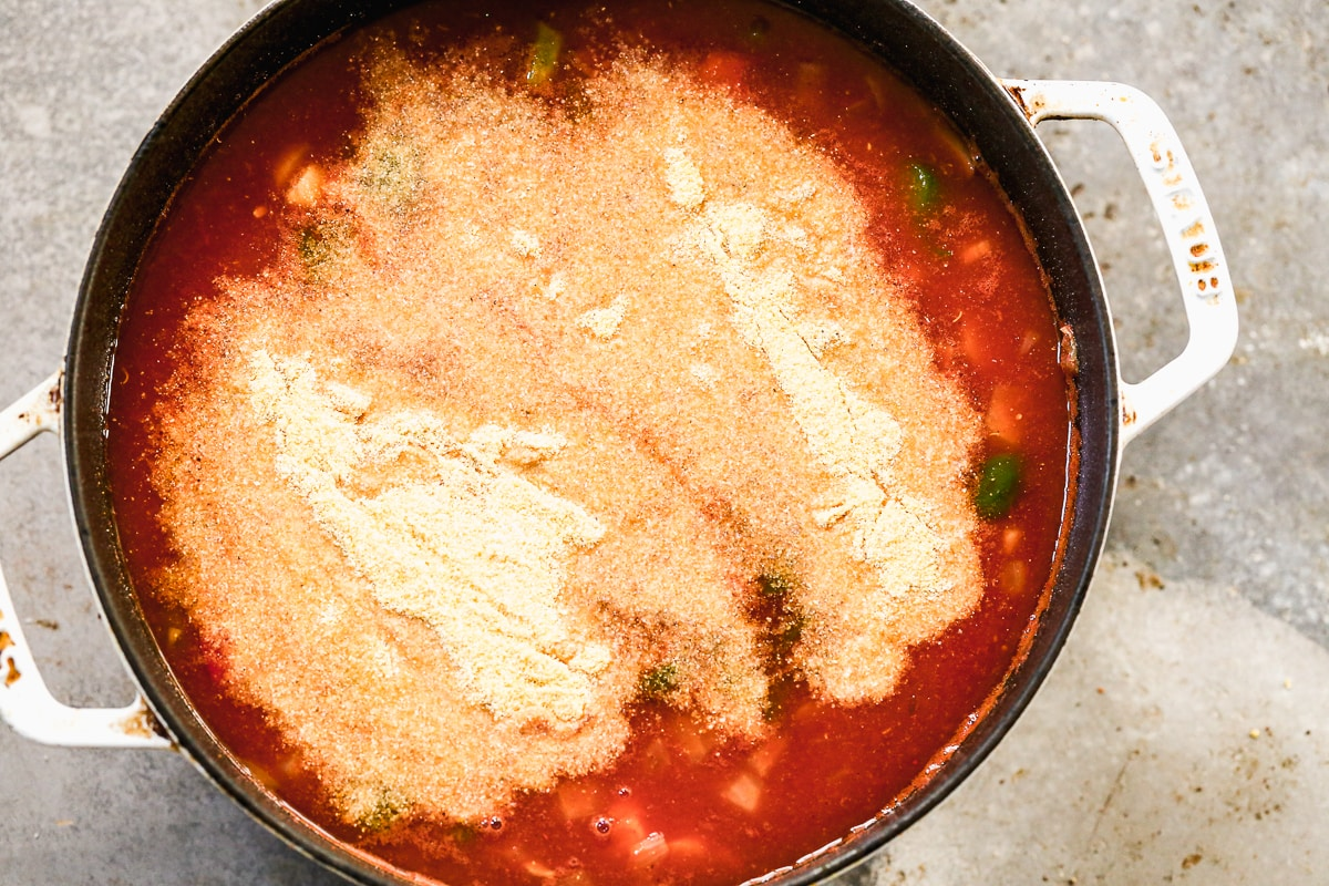 Cornmeal being added to a pot