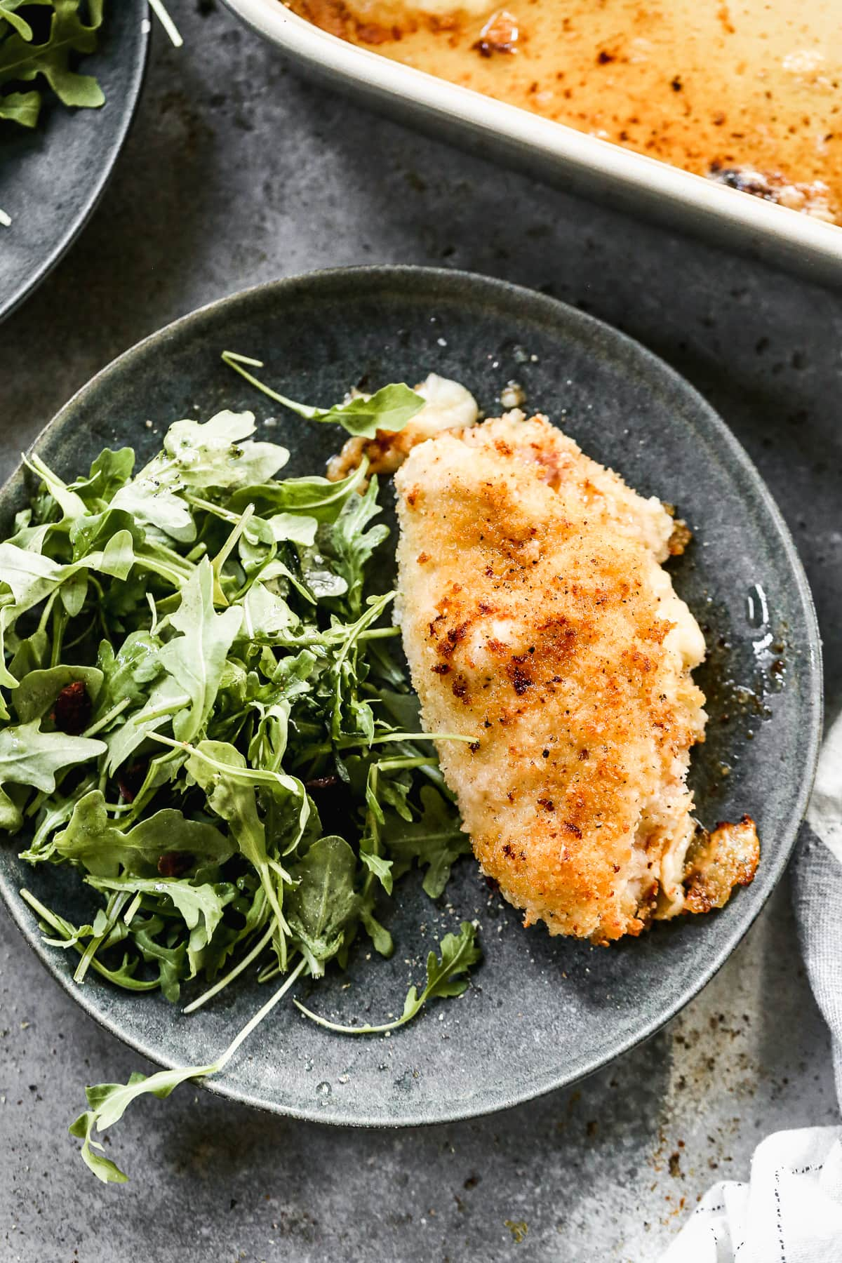 Oven baked chicken cordon bleu with arugula