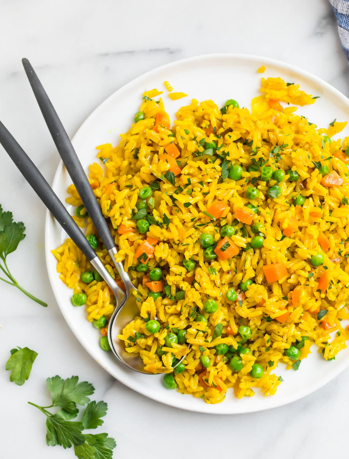 A plate of turmeric rice with vegetables