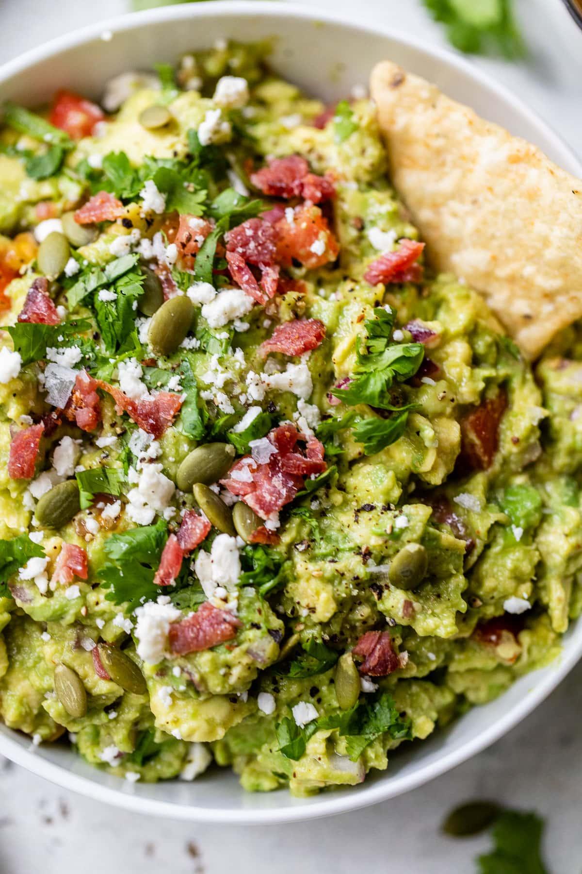 Healthy homemade guacamole in a bowl