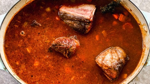 Tender red wine braised short ribs in a Dutch oven