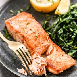 Pan seared salmon being flaked
